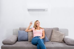 woman-operating-ductless-system
