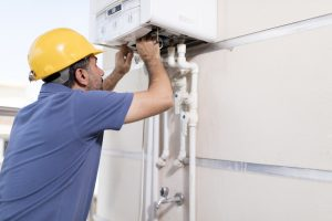 tech-working-on-gas-boiler
